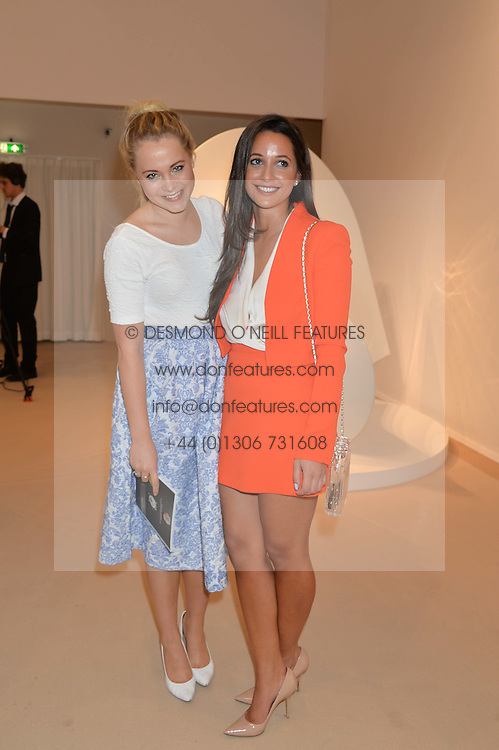 Left to right, POPPY JAMIE and ROXIE NAFOUSI at the Masterpiece Marie Curie Party supported by Jeager-LeCoultre held at the South Grounds of The Royal Hospital Chelsea, London on 30th June 2014.