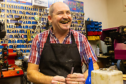 Shoe repair and key cutter Martin, 52, right, talks with Bild journalist Philip Fabian about Brexit in his Charing Cross shop in London. London, January 16 2019.