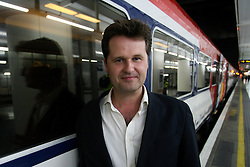© Licensed to London News Pictures. 20/06/2012. London,Britain..Philip Sheppard, Olympic composer is posing at the launch of Gatwick Express's Express Tracks.A photo call makes the launch of Gatwick Express's Express Tracks on Platform 13 in Victoria Station.  Photo credit : Thomas Campean/LNP..