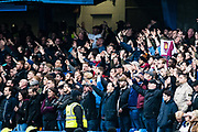 West Ham fans celebrate  after the Premier League match between Chelsea and West Ham United at Stamford Bridge, London, England on 8 April 2018. Picture by Sebastian Frej.
