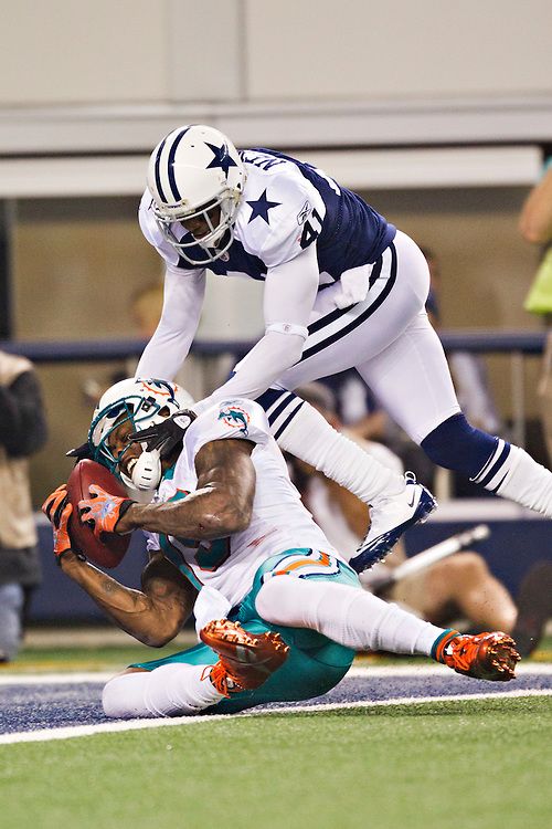 ARLINGTON, TX - NOVEMBER 24:   Brandon Marshall #19 of the Miami Dolphins catches a touchdown pass while being interfered with by Terence Newman #41 of the Dallas Cowboys at Cowboys Stadium on November 24, 2011 in Arlington, Texas.  The Cowboys defeated the Dolphins  20 to 19.  (Photo by Wesley Hitt/Getty Images) *** Local Caption *** Brandon Marshall; Terence Newman