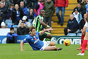 Ade Azeez of AFC Wimbledon and Adam Webster battle during the Sky Bet League 2 match between Portsmouth and AFC Wimbledon at Fratton Park, Portsmouth, England on 15 November 2015. Photo by Stuart Butcher.