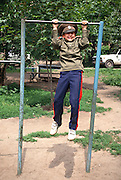 A young Russian Don Cossacks struggles to perform pull-ups at the Don Cossack Military School in Novocherkassk, Russia.