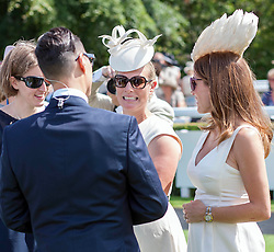 Zara Phillips and Natalie Pinkham discuss fashion with Gok Wan during a day at the races at Glorious Goodwood, but has no luck with his bet. Image ©Licensed to i-Images Picture Agency. 31/07/2014. Chichester, United Kingdom. Glorious Goodwood. Goodwood Racecourse. Picture by i-Images