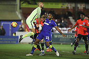 Brighton & Hove Albion goalkeeper Niki Maenpaa (1) and AFC Wimbledon striker Tyrone Barnett (23) battle for possession in the goal mouth during the EFL Trophy match between AFC Wimbledon and U23 Brighton and Hove Albion at the Cherry Red Records Stadium, Kingston, England on 6 December 2016. Photo by Stuart Butcher.