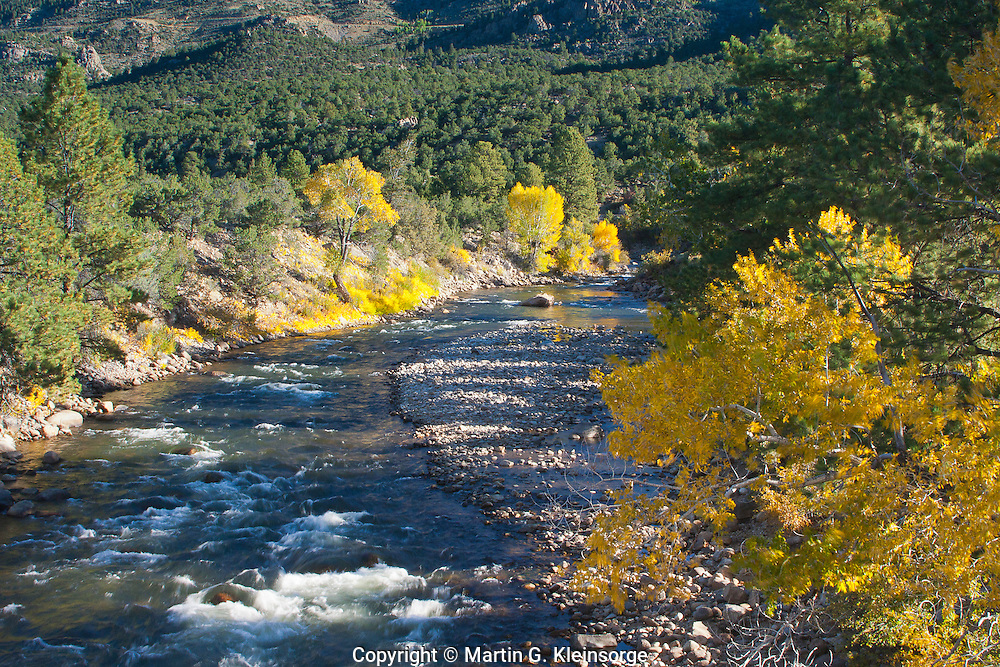 The Arkansas River flowing through the Upper Arkansas Valley during the autumn season.  Colorado.
