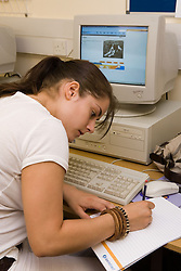 Young woman in an IT class; run by the Aspire Training Scheme for young mothers and mothers to be,