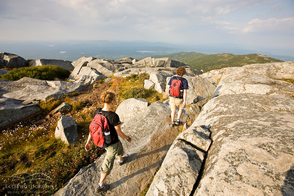A couple hikes near the summit of Mount Monadnock in Monadnock State Park in Jaffrey, New Hampshire.
