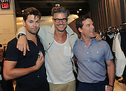 Actor Andrew Rannells, left, holding the new Timex Mod Watch, poses with his partner Mike Doyle, right, and Eric Rutherford, after the Todd Snyder Spring 2017 fashion show, Thursday, July 14, 2016, at New York Fashion Week: Men's.  (Diane Bondareff/AP Images for Timex)