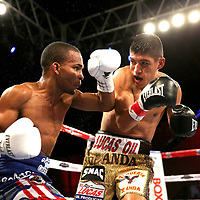 Jonathan Gonzalez (L) fights against Richard Rodriguez during a Telemundo boxing match between at Osceola Heritage Park on Friday, February 23, 2018 in Kissimmee, Florida.  (Alex Menendez via AP)