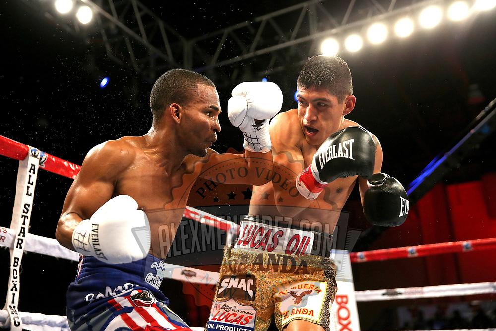 Jonathan Gonzalez (L) fights against Richard Rodriguez during a Telemundo boxing match between at Osceola Heritage Park on Friday, February 23, 2018 in Kissimmee, Florida.  (Alex Menendez via AP)