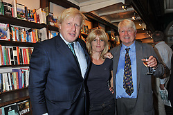 Left to right, Mayor of London BORIS JOHNSON, his sister RACHEL JOHNSON and their father STANLEY JOHNSON at a party to celebrate the publication of Stanley Johnson's new book 'Where The Wild Things Were' held at Daunt Books, 83 Marylebone High Street, London W1 on 18th July 2012.