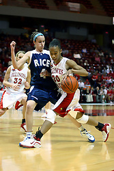 15 March 2007: Tiffany Hudson watches her control of the ball as she bounces against Kadie Riverin.  The Owls of Rice university visited the Redbirds of Illinois State University at Redbird Arena in Normal Illinois for a round one WNIT game.