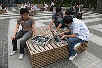Seoul, South Korea Korean students working on a new navigation software in Gangnam, Seoul, South Korea. 2009<br /> <br /> Etudiants coreens testent un nouveau logiciel de navigation dans le quartier de Gangnam, Seoul.