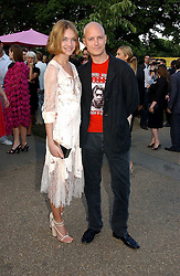 The HON.JUSTIN PORTMAN and NATALIA VODIANOVA at the Serpentine Gallery Summer party sponsored by Yves Saint Laurent held at the Serpentine Gallery, Kensington Gardens, London W2 on 11th July 2006.<br />