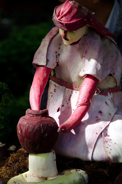 Figure of a potter carved from radishes at the Noche de Rabanos / Night of the Radishes Festival, Oaxaca, Mexico.