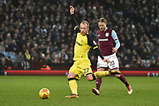 Burton Albion striker Liam Boyce (27) plays the ball from Aston Villa midfielder Birkir Bjarnason (20) during the EFL Sky Bet Championship match between Aston Villa and Burton Albion at Villa Park, Birmingham, England on 3 February 2018. Picture by Richard Holmes.