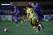 AFC Wimbledon defender Paul Robinson (6) fouls Sutton United Matt Tubbs (28) during the The FA Cup third round replay match between AFC Wimbledon and Sutton United at the Cherry Red Records Stadium, Kingston, England on 17 January 2017. Photo by Stuart Butcher.