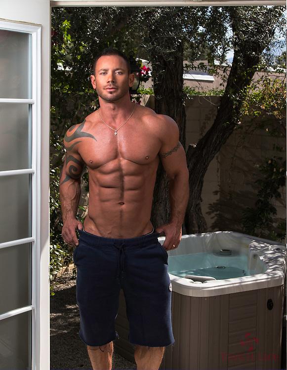 Scott Cullens standing in a doorway in front of a hottub