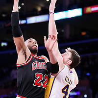 09 February 2014: Chicago Bulls power forward Taj Gibson (22) goes for the skyhook over Los Angeles Lakers power forward Ryan Kelly (4) during the Chicago Bulls 92-86 victory over the Los Angeles Lakers at the Staples Center, Los Angeles, California, USA.