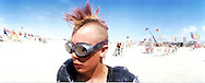 """Sick Boy"", a citezen of Black Rock City makes his way across the desert during the16th annual Burning Man festival August 31, 2001 in the Black Rock Desert near Gerlach, Nevada.An estimated record 29,000 people camped out on a remote desert playa, or dry lake, for the week-long counter-cultural celebration of art and ""radical self-expression."" This year's theme was thethe stages of man."