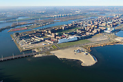 Nederland, Noord-Holland, Amsterdam, 11-12-2013; IJburg met Haveneiland en Rietlanden daar achter. Onder Benno Premeselabrug en Blijburg, begin van IJburg II (Centrum eiland).<br /> Overview of IJburg, the new urban development district of Amsterdam, highrise buildings of the the Haveneiland( Harbour Island) (m).<br /> luchtfoto (toeslag op standard tarieven);<br /> aerial photo (additional fee required);<br /> copyright foto/photo Siebe Swart
