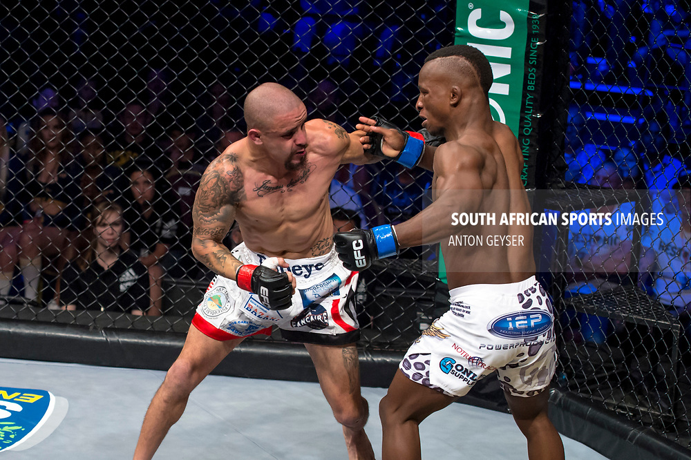 JOHANNESBURG, SOUTH AFRICA -NOVEMBER 04: (R-L) Bokang Masunyane and Magno Alves - Flyweight - in action during EFC 65 Fight Night at Carnival City on November 04, 2017 in Johannesburg, South Africa. (Photo by Anton Geyser/EFC Worldwide/Gallo Images)