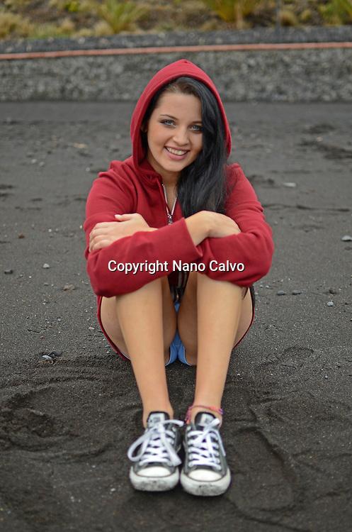 Cute brunette teenager on the beach