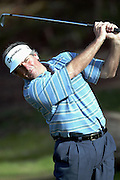 Professional golfer Fred Couples hits an iron shot in a round two match at the Accenture Match Play Championship World Golf Championships held at the La Costa Resort and Spa on February 27, 2004 in Carlsbad, California. ©Paul Anthony Spinelli