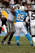 Los Angeles Chargers tight end Antonio Gates (85) scuffles with Oakland Raiders linebacker Marquel Lee (55) on a fourth quarter play in which the Raiders LB gets hit with a 15 yard roughing penalty during the NFL week 5 regular season football game against the Oakland Raiders on Sunday, Oct. 7, 2018 in Carson, Calif. The Chargers won the game 26-10. (©Paul Anthony Spinelli)