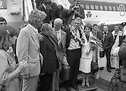 "Fr Niall O'Brien Returns from Captivity.1984..14.07.1984..07.14.1984..On 6 May 1983,Fr Niall O'Brien was arrested along with two other priests, Fr. Brian Gore, an Australian, Fr. Vicente Dangan, a Filipino and six lay workers - the so-called ""Negros Nine"", for the murders of Mayor Pablo Sola of Kabankalan and four companions. The priests where held under house arrest for eight months but ""escaped"" to prison in Bacolod City, the provincial capital, where they felt they would be safer.The case received widespread publicity in Ireland and Australia, the home of one of the co-accused priests, Fr. Brian Gore. When Ronald Reagan visited Ireland in 1984, he was asked on Irish TV how he could help the missionary priest's situation. A phone call the next day from the Reagan administration to Ferdinand Marcos resulted in Marcos offering a pardon to Fr. O'Brien and his co-accused..(Ref Wikipedia)...Picture shows Fr Niall O'Brien with his parents Mr and Mrs O'Brien and Cardinal Tomas O Fiach as he descended the aircraft stairs at Dublin Airport. Also included is Mr Jim O'Keefe TD,Minister of State at the Dept of Foreign Affairs."