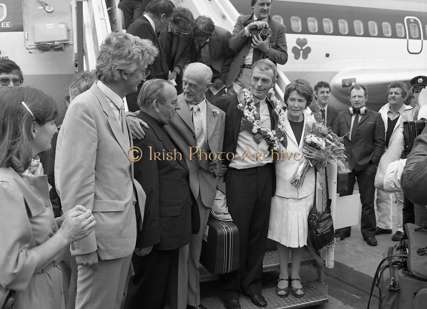 """Fr Niall O'Brien Returns from Captivity.1984..14.07.1984..07.14.1984..On 6 May 1983,Fr Niall O'Brien was arrested along with two other priests, Fr. Brian Gore, an Australian, Fr. Vicente Dangan, a Filipino and six lay workers - the so-called """"Negros Nine"""", for the murders of Mayor Pablo Sola of Kabankalan and four companions. The priests where held under house arrest for eight months but """"escaped"""" to prison in Bacolod City, the provincial capital, where they felt they would be safer.The case received widespread publicity in Ireland and Australia, the home of one of the co-accused priests, Fr. Brian Gore. When Ronald Reagan visited Ireland in 1984, he was asked on Irish TV how he could help the missionary priest's situation. A phone call the next day from the Reagan administration to Ferdinand Marcos resulted in Marcos offering a pardon to Fr. O'Brien and his co-accused..(Ref Wikipedia)...Picture shows Fr Niall O'Brien with his parents Mr and Mrs O'Brien and Cardinal Tomas O Fiach as he descended the aircraft stairs at Dublin Airport. Also included is Mr Jim O'Keefe TD,Minister of State at the Dept of Foreign Affairs."""