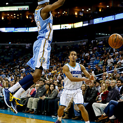 Mar 25, 2013; New Orleans, LA, USA; New Orleans Hornets point guard Brian Roberts (22) passes as Denver Nuggets small forward Corey Brewer (13) defends during the second quarter of a game at the New Orleans Arena. Mandatory Credit: Derick E. Hingle-USA TODAY Sports