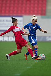 LLANELLI, WALES - Thursday, March 31, 2011: Iceland's Fjolla Shala and Turkey's Sevgi C?inar during the UEFA European Women's Under-19 Championship Second Qualifying Round (Group 3) match at Parc Y Scarlets. (Photo by David Rawcliffe/Propaganda)
