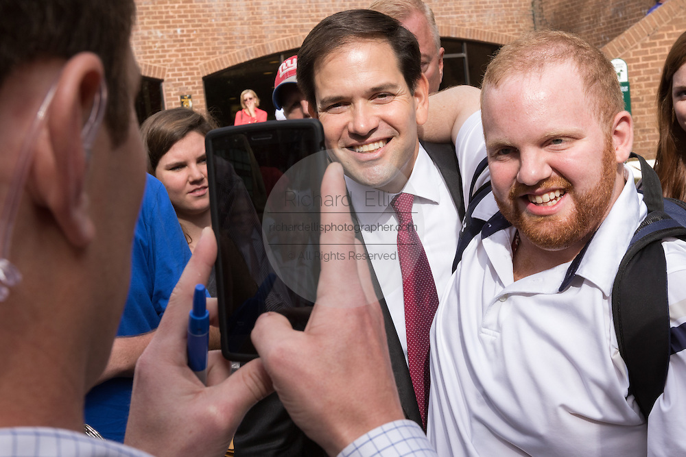 Senator and GOP presidential candidate Marco Rubio poses for a photo with a student following his appearance at the Bully Pulpit series town hall at the College of Charleston December 1, 2015 in Charleston, South Carolina.
