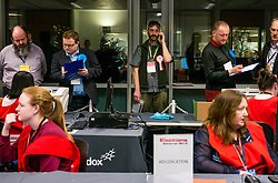 Pictured: Leith Walk Council By-Election. Edinburgh City Council, Edinburgh, Scotland, 11 April 2019. Pictured: David Don Jacobsen, Socialist Labour Party candidate on his phone. 25,526 residents are registered to vote in one of the most densely populated areas in Scotland under the Single Transferable Vote (STV) system. This is the first time in Scotland that an STV by-election has been needed to fill two vacancies in the same ward, held as a result of the resignation of Councillor Marion Donaldson. The election fielded 11 candidates, including the first ever candidate for the For Britain Movement in Scotland, Paul Stirling, founded by former UKIP leadership candidate Anne Marie Waters in March 2018.<br /> <br /> Sally Anderson   EdinburghElitemedia.co.uk