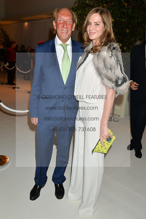 VISCOUNT DAVENTRY and TRINNY WOODALL at a dinner hosted by Cartier in celebration of The Chelsea Flower Show held at The Hurlingham Club, London on 19th May 2014.