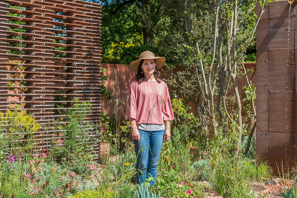 Sarah Price in her  M&G Garden, Sponsor: M&G Investments, Designer: Sarah Price and Contractor: Crocus - The RHS Chelsea Flower Show at the Royal Hospital, Chelsea.