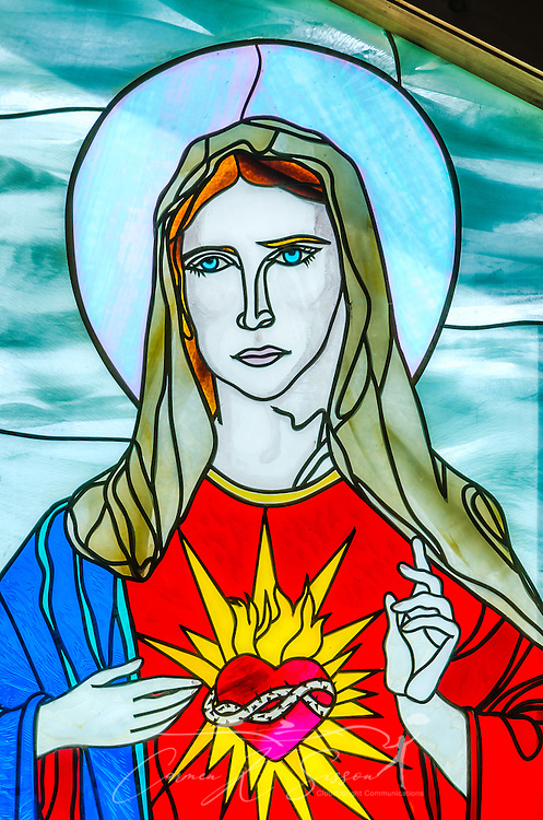 A stained glass window featuring Jesus is one of the highlights at Chapel of Mercy in Greenwood, Miss. (Photo by Carmen K. Sisson)