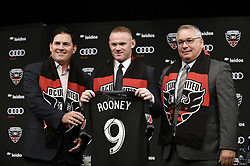 English international soccer player Wayne Rooney flanked by United Managing Partner and CEO Jason Levien (L) , and United General Manager and VP of Soccer Operations Dave Kasper , pose during the media unveiling at the Newseum on July 2, 2018 in Washington, DC..Photo by Olivier Douliery/ Abaca Press