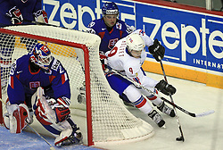 Marius Holtet of Norway, behind Tomas Starosta and left goalkeeper Jan Lasak  at ice-hockey match Slovakia vs Norway at Preliminary Round (group C) of IIHF WC 2008 in Halifax, on May 03, 2008 in Metro Center, Halifax, Canada. (Photo by Vid Ponikvar / Sportal Images)