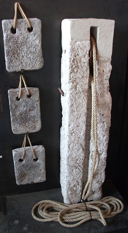 Lead weights and part of a hoist used in the underground structure if the Flavian amphitheatre. 3rd century AD. Roman.