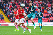 Barnsley midfielder Kenny Dougall (4) and Swansea City midfielder George Byers (28) in action during the EFL Sky Bet Championship match between Barnsley and Swansea City at Oakwell, Barnsley, England on 19 October 2019.