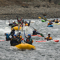 Rafters and kayakers pass through a narrow section or the White Salmon River that was once home to the Condit Dam. For nearly 100-years the Condit Dam blocked the White Salmon River. In 2011 PacificCorp started the decommissioning process of the dam, and on Nov. 5, 2012 with the dam gone opened the lower section of the White Salmon River to boaters.