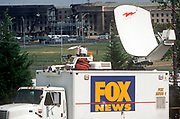 Days after the 9-11 terrorist attacks, a Fox News satellite truck is positioned opposite the Pentagon which was badly damaged by the crashed Americans Airline flight 77, on 18th September 2001, Washington DC, USA. (Photo by Richard Baker / In Pictures via Getty Images)