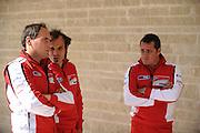 April 19-21, 2013- Ducati team members watch Honda warm up a bike.