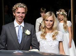 Poppy Delevingne and James Cook  leaving St.Paul's Church in Knightsbridge, London after their wedding,   Friday, 16th May 2014. Picture by Stephen Lock / i-Images