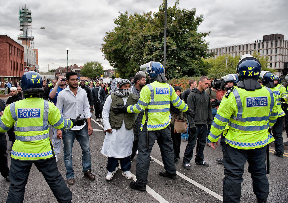 LONDON, ENGLAND - SEPTEMBER 11:  Police contains Muslim protesters in front of  Harrow Central Mosque on September 11, 2009 in London, England.  (Photo by Marco Secchi/Getty Images)