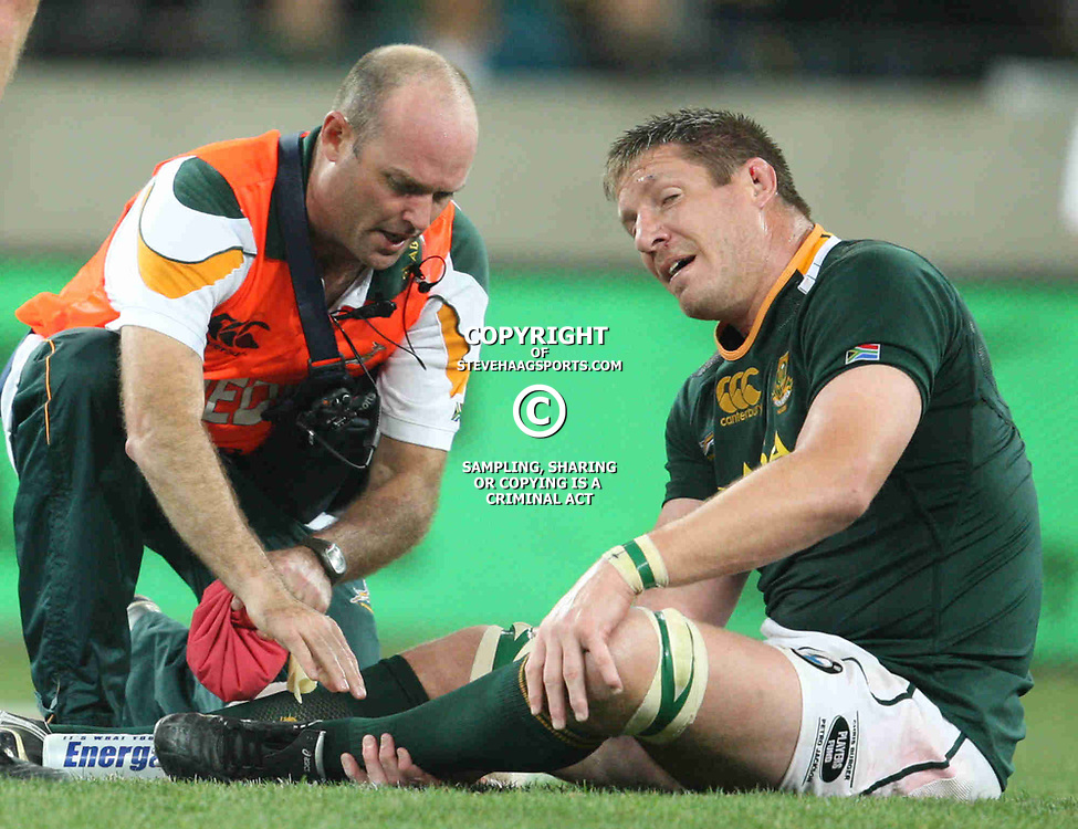 PORT ELIZABETH, SOUTH AFRICA - AUGUST 20, Bakkies Botha lies on the ground injured during the Castle Lager Tri Nations match between South Africa and New Zealand from Nelson Mandela Bay Stadium on August 20, 2011 in Port Elizabeth, South Africa<br /> Photo by Steve Haag / Gallo Images