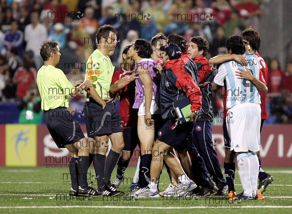 Chilean players confronts the officials at the end of their 3-0 semi-final loss to Argentina at the FIFA U-20 World Cup on 19 July 2007 in Toronto, Ontario, Canada.  .AFP PHOTO/GEOFF ROBINS